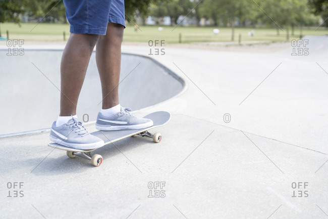 Man standing on skateboard