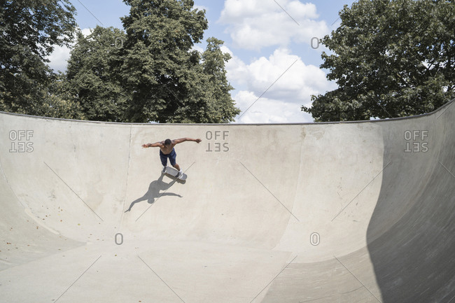 Man skating in skate park