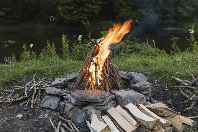 Campfire burning in stone circle