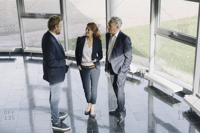 Business people talking at the window in modern office building