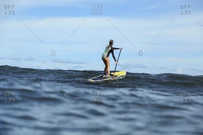 Female SUP surfer- Bali- Indonesia
