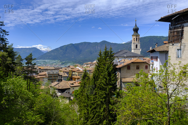 Italy- Trentino- Fondo- Countryside town in spring with mountains in background