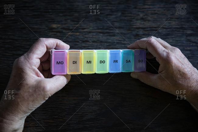 Senior holding pill box