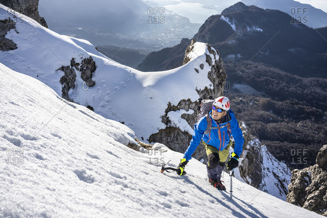 Alpinist ascending a snowy mountain- Orobie Alps- Lecco- Italy