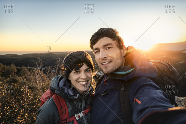 Selfie of happy couple at the Ligurian coast at sunset- Finale Ligure- Italy