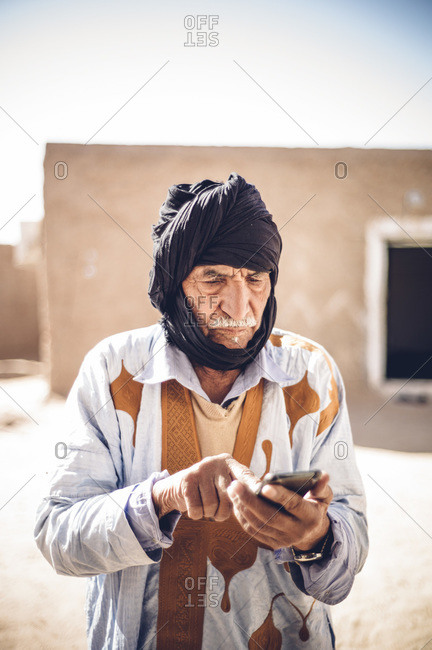 Senior man using cell phone in Smara refugee camp- Tindouf- Algeria
