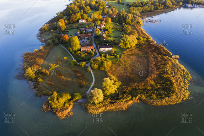 Germany- Bavaria- Aerial view of Urfahrn peninsula on Chiemsee lake