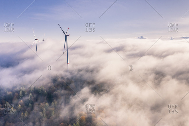 Germany- Baden-Wurttemberg- Goldboden- Wind farm shrouded in autumn fog
