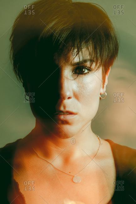 Thoughtful sensual young woman in studio