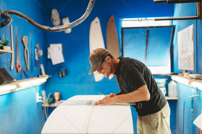 Craftsman making surf board in workshop