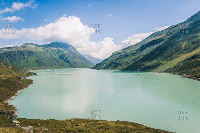 Landscape with secluded clean lake with blue water surrounded by hills in Austria countryside