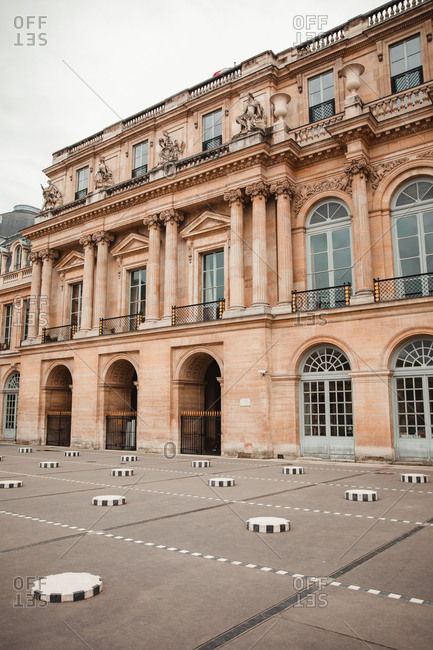 Palais royal palace in square of Paris on cloudy day