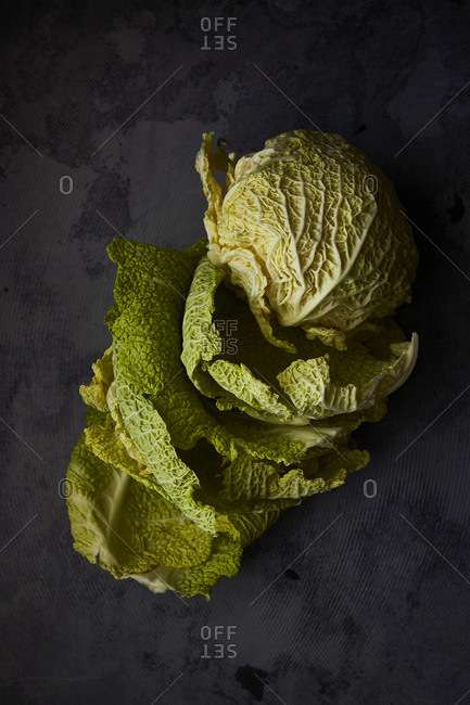 Overhead view of cabbage on dark background