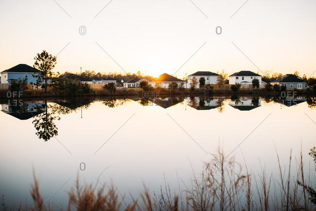 Sunset over lake and suburban homes