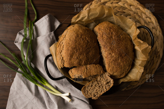 Overhead view of bread and spring onion