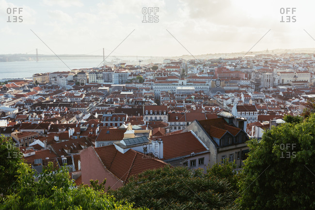 Roofs of lovely houses of coastal town located near sea in cloudy evening in Portugal