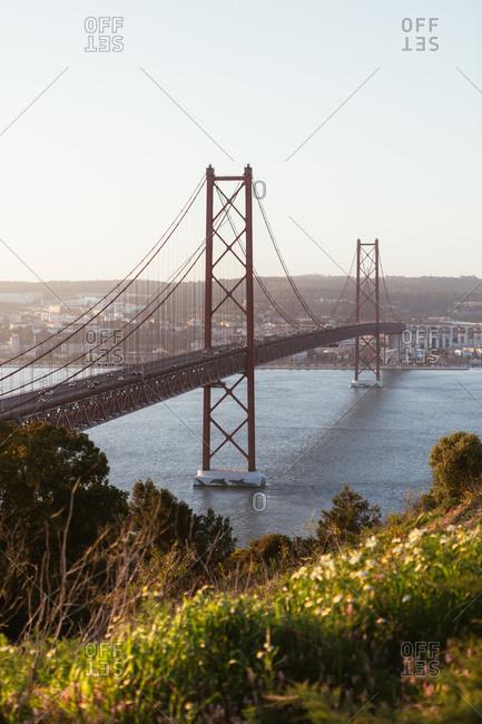 Suspension bridge over river in city