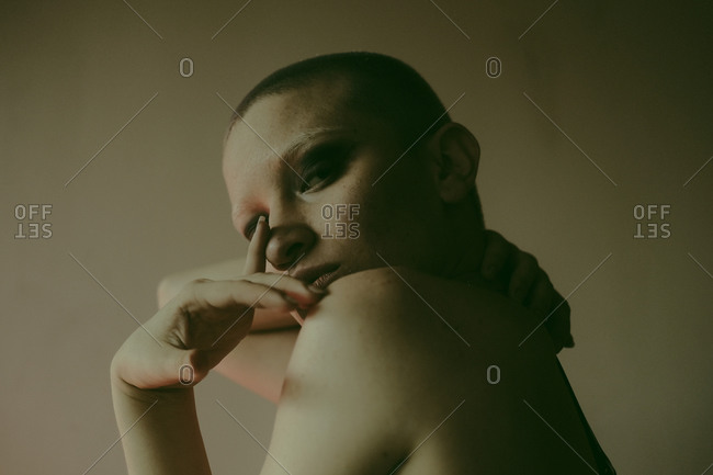 Sexy naked bald woman in dark studio