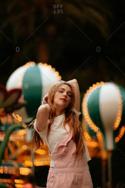 Stylish teenage girl standing in amusement park