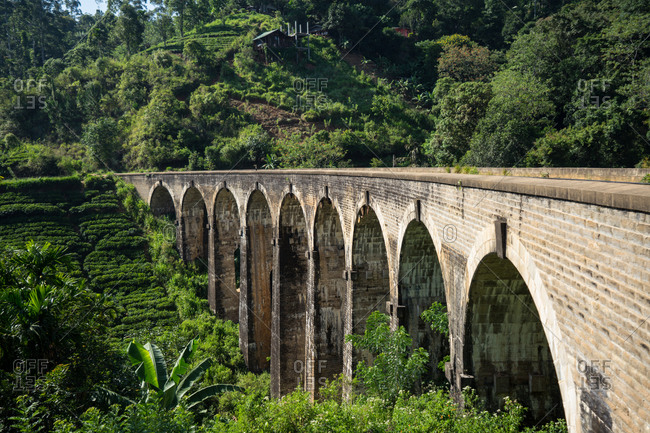 Stunning picturesque landscape of old bridge with railway surrounded by green forest in Nine Arches Bridge, Ella, Sri Lanka