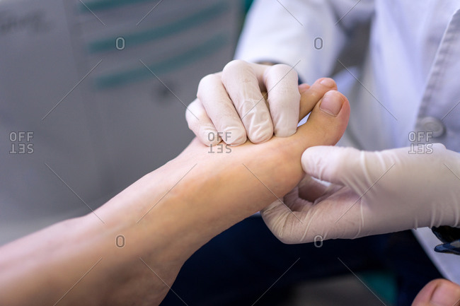 Podiatrist examining and treating patient