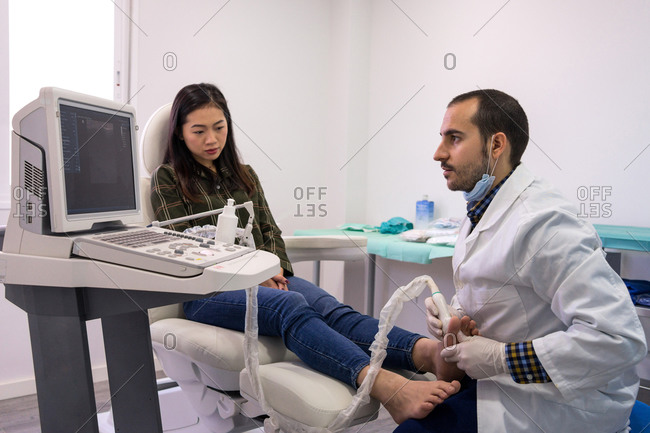 Podiatry doctor using ultrasound scanner