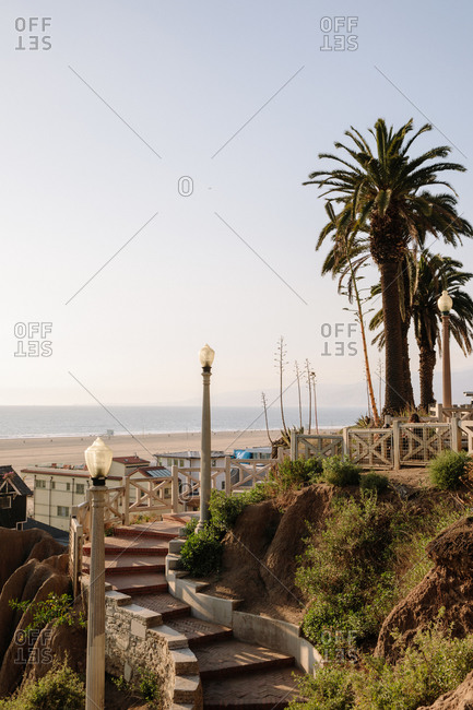 Steps leading up hillside overlooking beach on the coast of Santa Monica, California