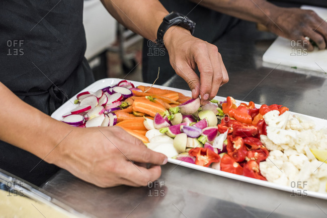 Chefs preparing a vegetable crudite platter