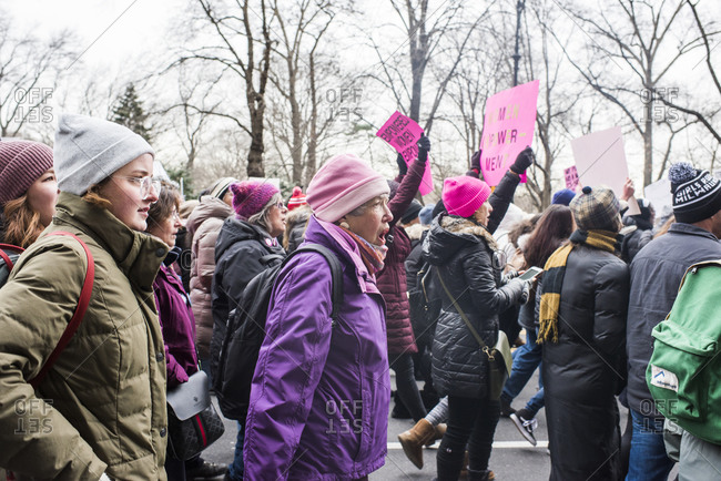 Manhattan, New York, USA - January 18, 2020: Group marching down street at the Women's March, New York City
