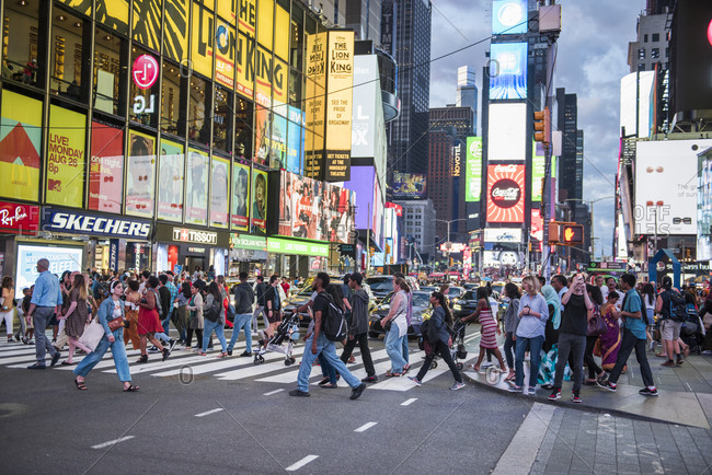New York City, New York - August 24, 2019: Crowd crossing street in Times Square, NYC