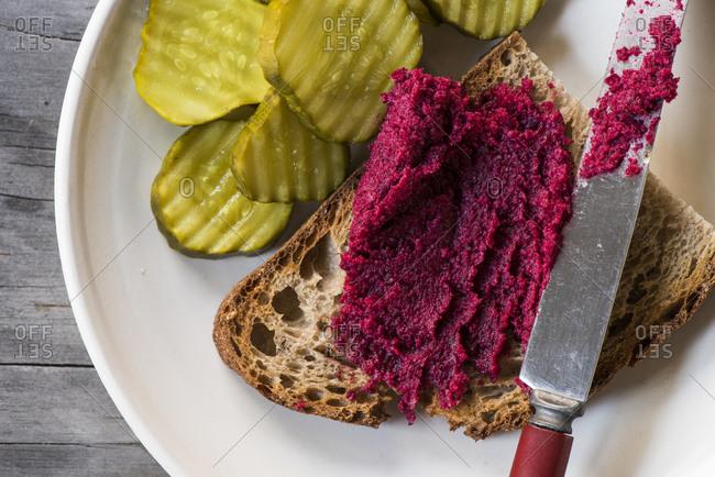 Salt-roasted beet mousse on toast with pickles