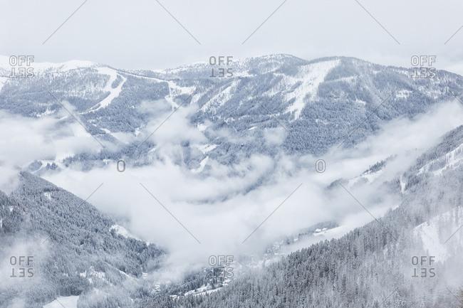 The Brunnach ski area and the St Oswald village in the clouds, Bad Kleinkirchheim, Carinthia, Austria, Europe