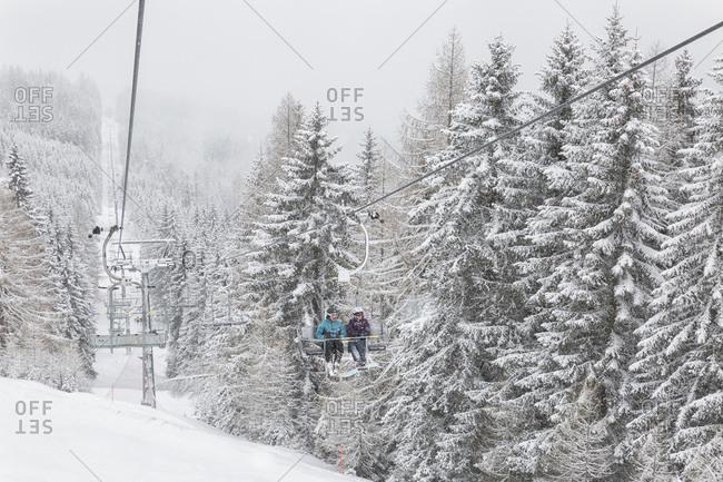 March 18, 2019: Skiers in the chair lift of Maibrunnbahn, Bad Kleinkirchheimm, Carinthia, Austria, Europe