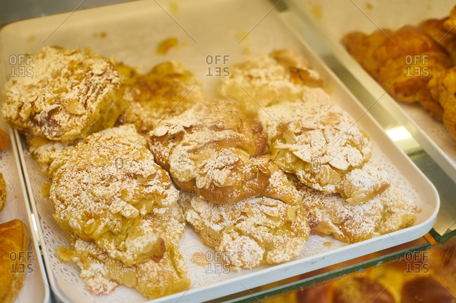 Almond croissants at the display of traditional jewish bakery at Marais quartier in Paris