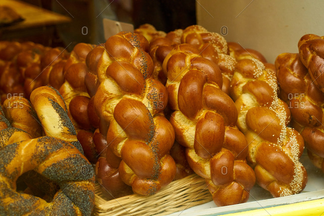 Challah and buns at the display of traditional jewish bakery at Marais quartier in Paris