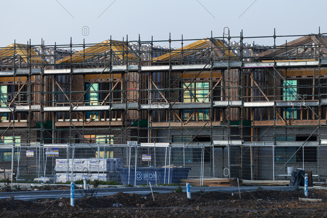 Rowville, Victoria, Australia - June 24, 2019: Complex of low rise residence buildings under construction with scaffolding providing platform for workers