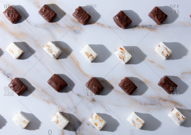 Chocolates are on the table lined up in rows