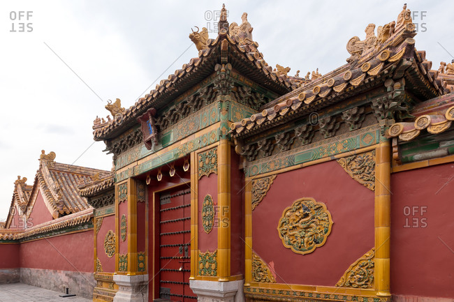 One of the many entrances of a corridor with beautiful decorated doors in the Forbidden City, Beijing