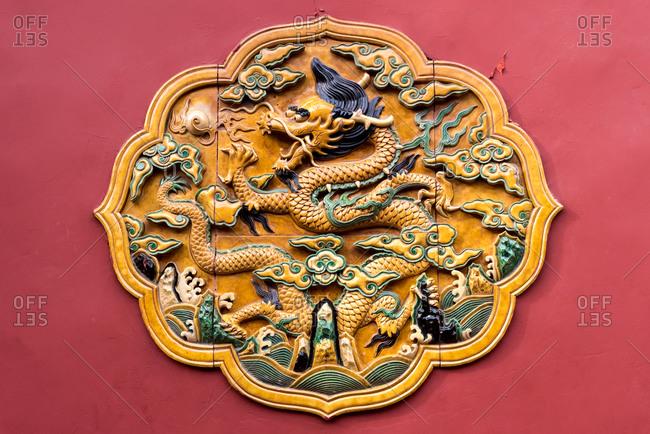 Decorative terracotta tiles with yellow dragon motif