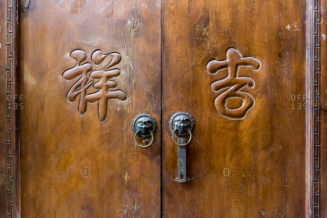 March, 15. 2019: Detail of a wooden old door. Lijiang, China