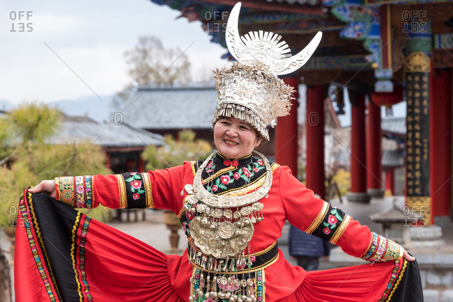 March, 16. 2019: Woman wearing costume of a Yunnan Minority. Lijiang, Yunnan Province, China.