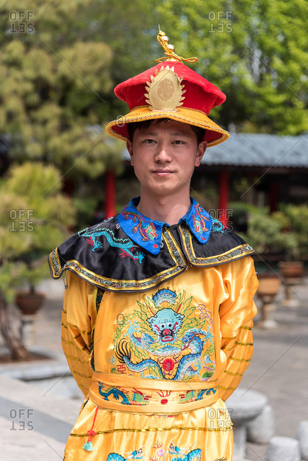 March, 16. 2019: Man wearing traditional Imperial era costume. Lijiang, Yunnan Province, China.
