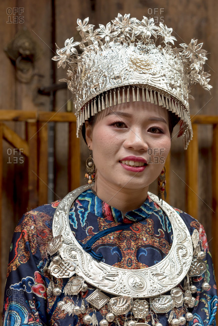 March, 17. 2019: Woman wearing traditional Imperial era   costume. Lijiang, Yunnan Province, China.