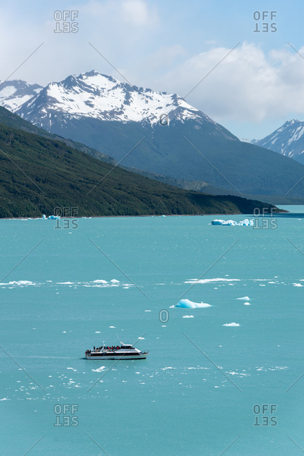 December 5, 2019: Boat on the lake of The Perito Moreno Glacier on a sunny day. Los Glaciares National Park. Argentina