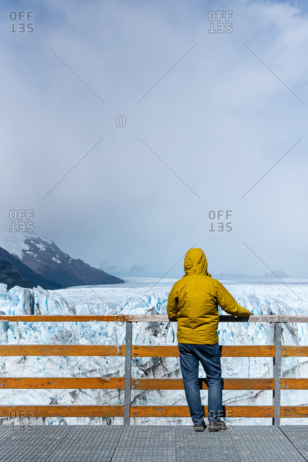Tourist photographing glacier on a dslr camera  from a viewpoint. Perito moreno, Argentina