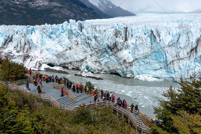 December 5, 2019: Tourists viewing The Perito Moreno Glacier from a platform. Perito Moreno, Argentina