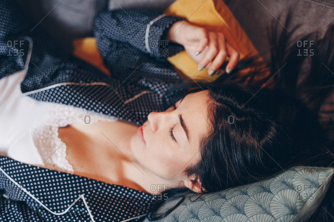 Portrait of beautiful happy young woman sleeping in bed