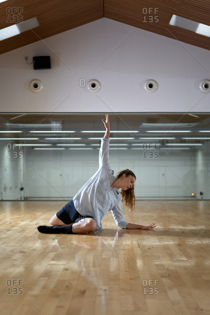 Side view of talented woman dancing in a studio