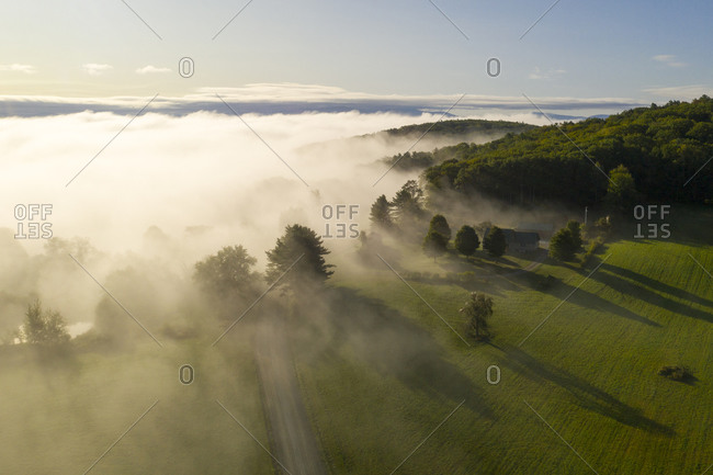 Fog rolling over countryside in Ryegate, Vermont