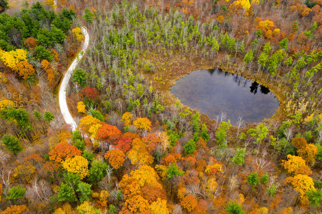 Fall colors and a round pond along a country road in Sudbury, Vermont